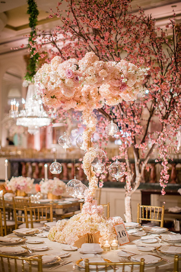 Opulent floral 'trees' rise up form table centres at this glamorous Beverly Hills   event. Photography: Samuel Lippke Studios