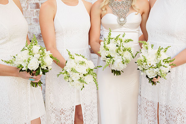 White bridesmaid dresses and flowers