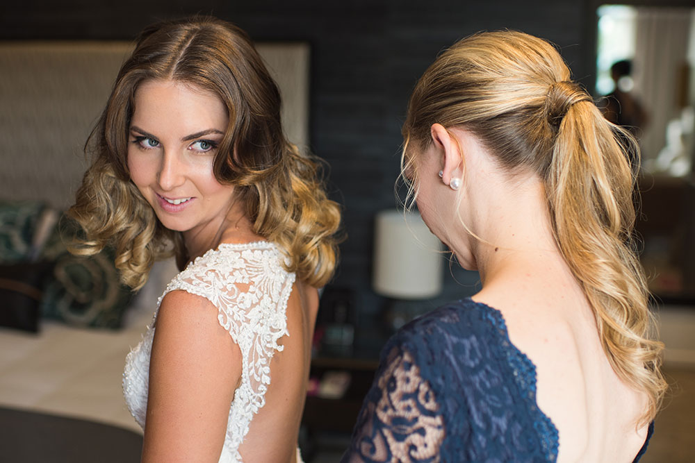 Kirsty's bridesmaid helping her get ready