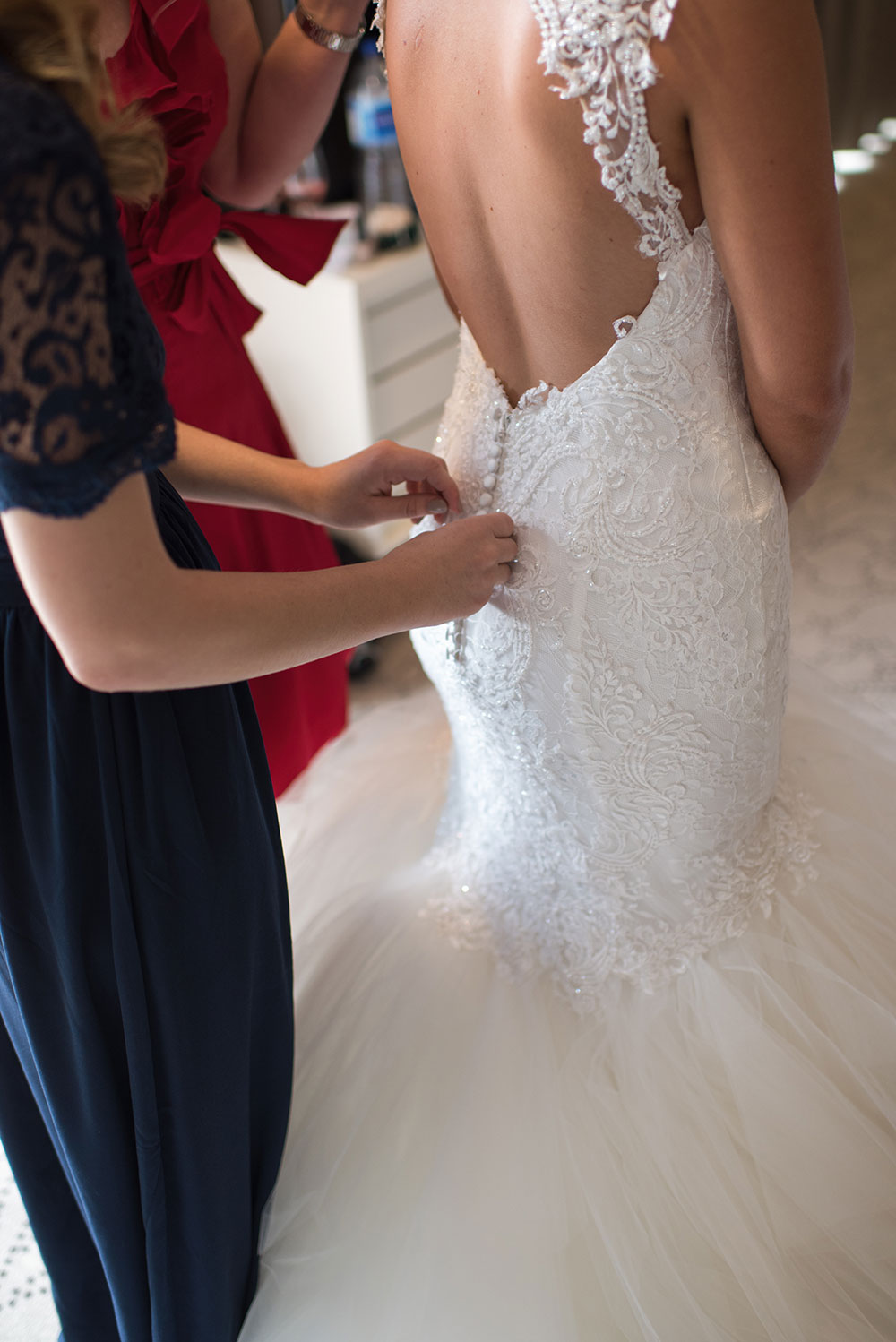 Buttoning up the gown