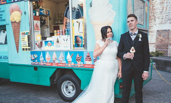 The bride and groom sharing some ice cream