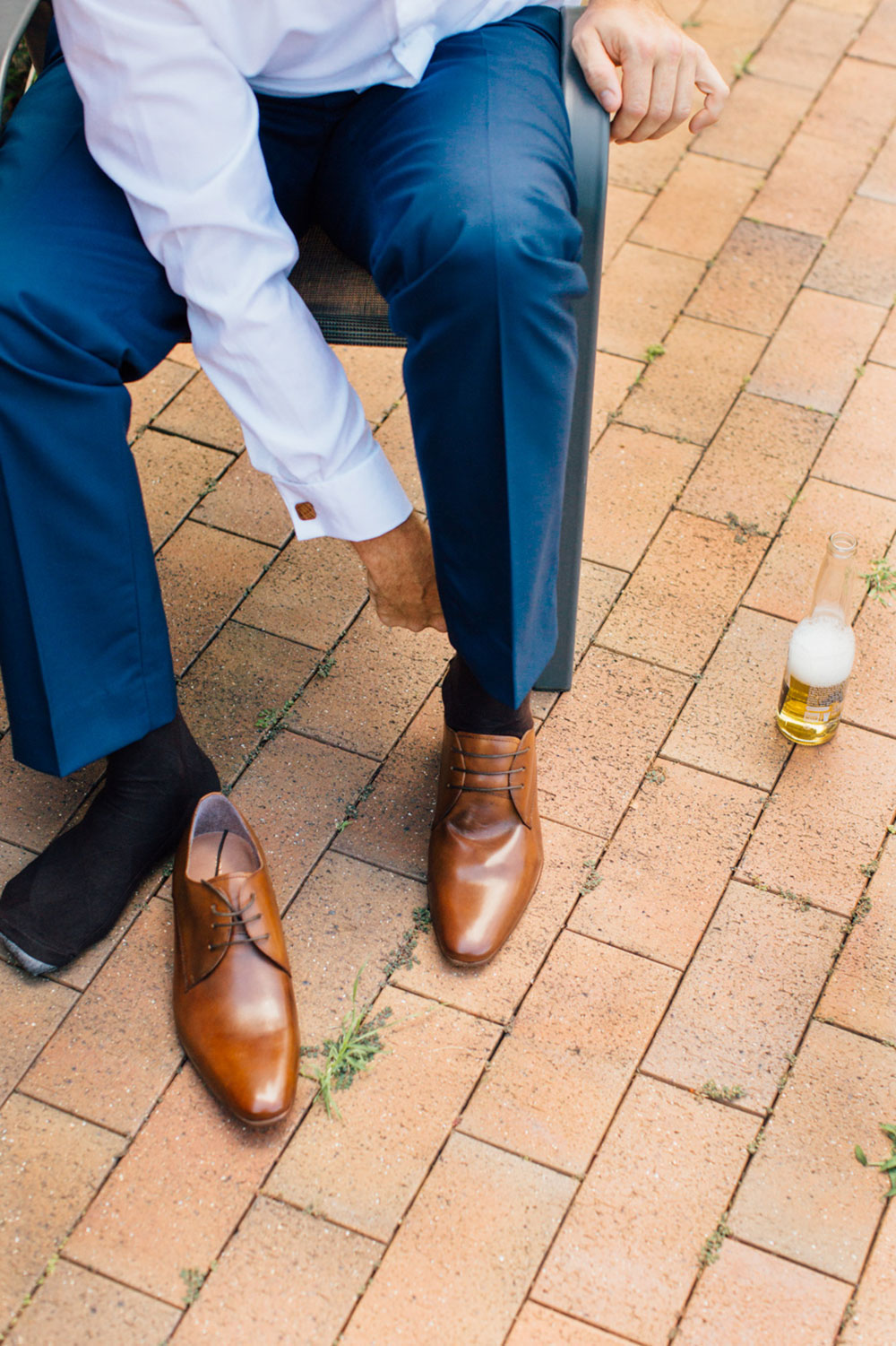 The groom tying his shoes