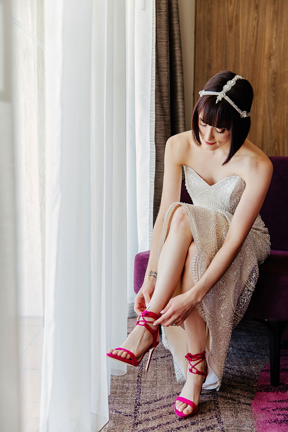 The bride lacing her shoes