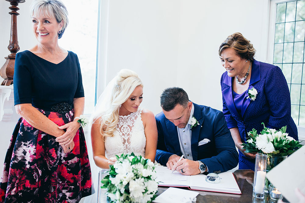 Signing the papers