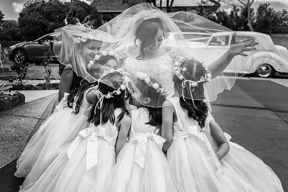 The bride and her flowergirls
