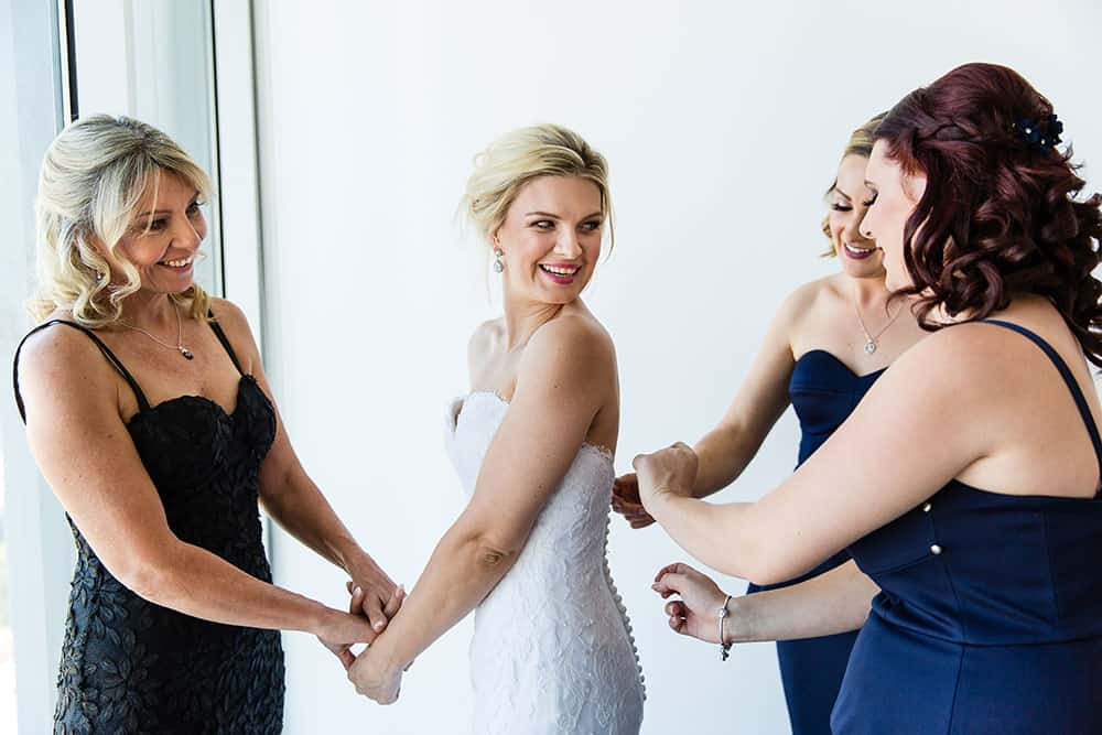 Getting some help from her bridesmaids