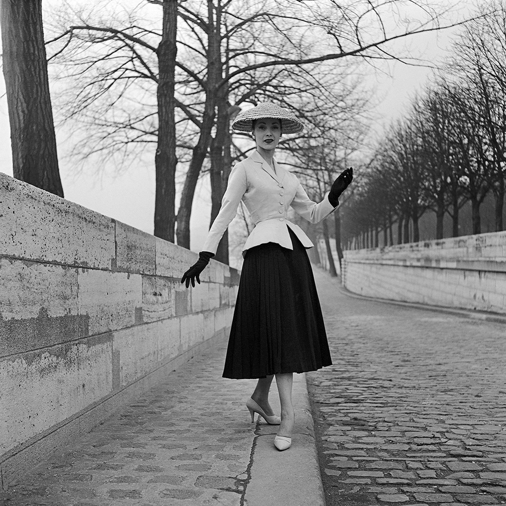 Christian Dior, Paris (fashion house) Christian Dior (designer) Bar suit spring−summer 1947 collection, modelled by Renee 1955 gelatin silver photograph Photograph by Willy Maywald Collection of Christian Dior Archives, Paris