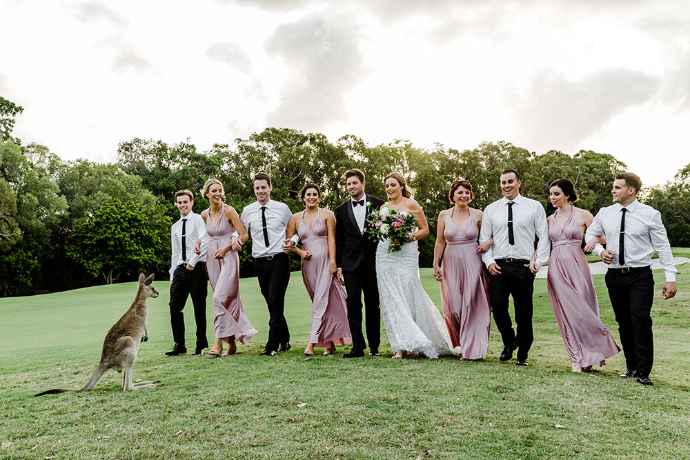 The bridal party and a guest