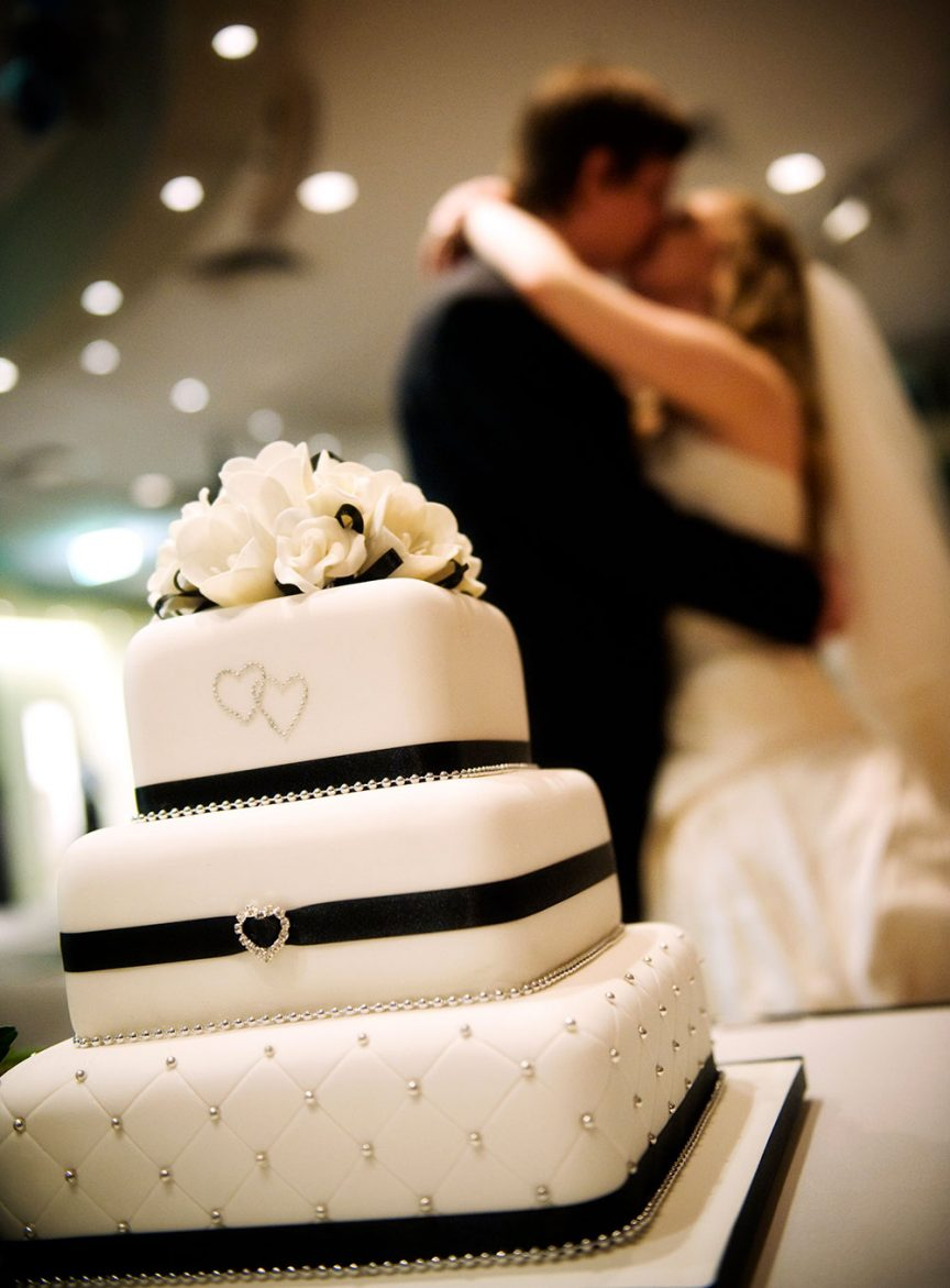 Classic black and white wedding cake with ribbon and diamonte details
