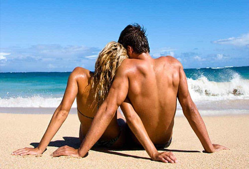 Honeymooning couple on a beach.