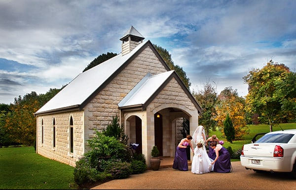 Hinterland weddings: Bride and bridesmaids getting ready to go into the chapel at The Cedar Creek Estate & Winery