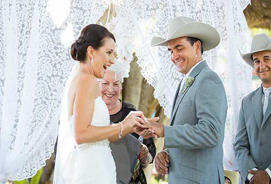 Bridal blues: Bride and groom at their wedding