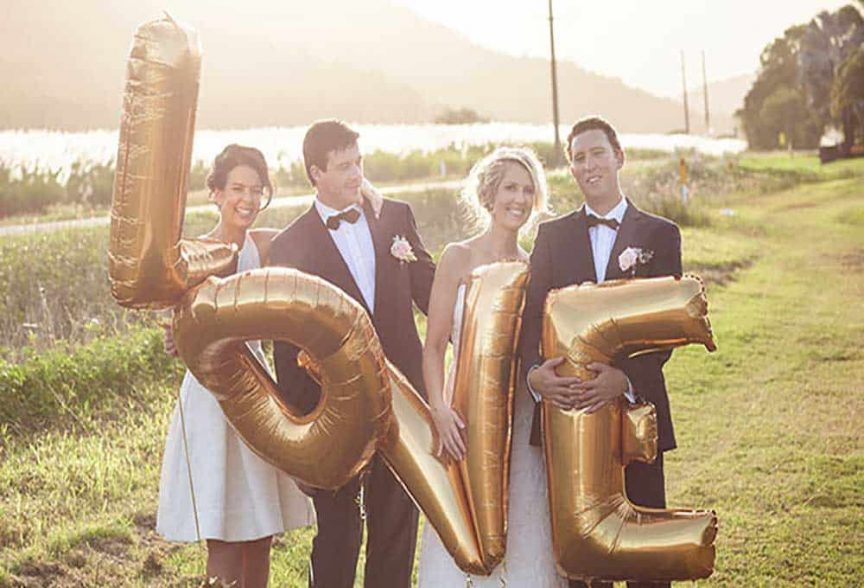 Bridal party with a LOVE balloon.