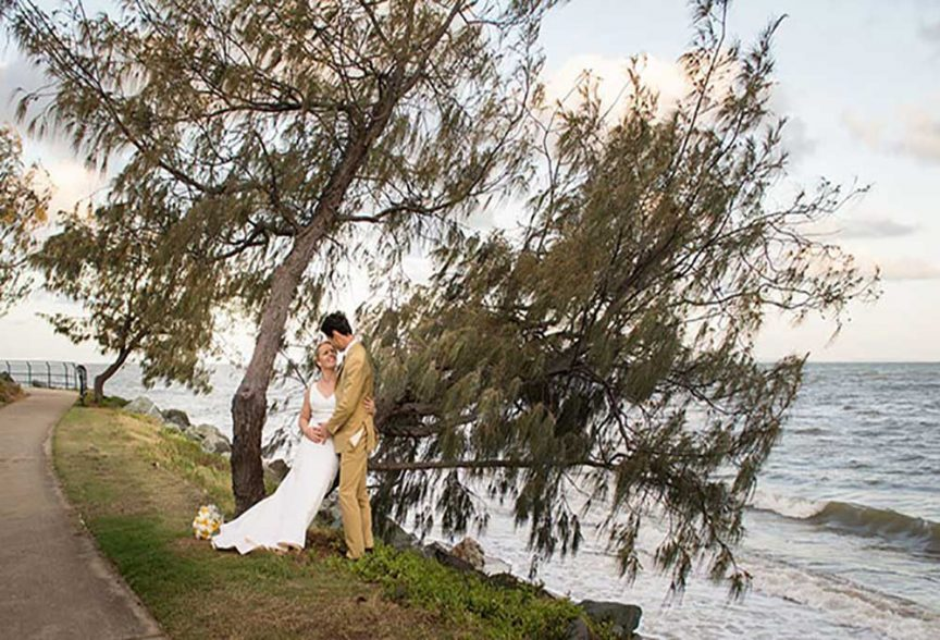 Bride and groom having a redcliffe wedding