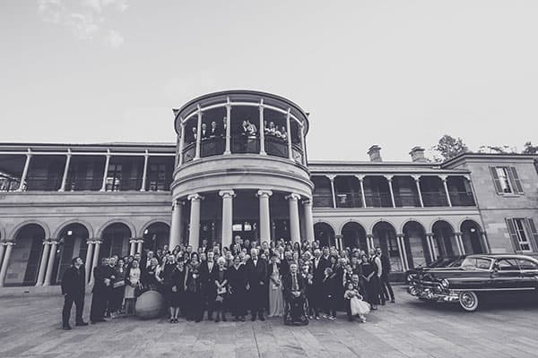 All the wedding guests standing outside Old Goverment House.