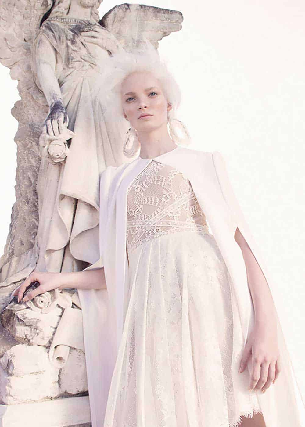 "The ""Apollo"" short lace wedding dress and matching cape from the George Wu Sancta Sedes 2016 collection."
