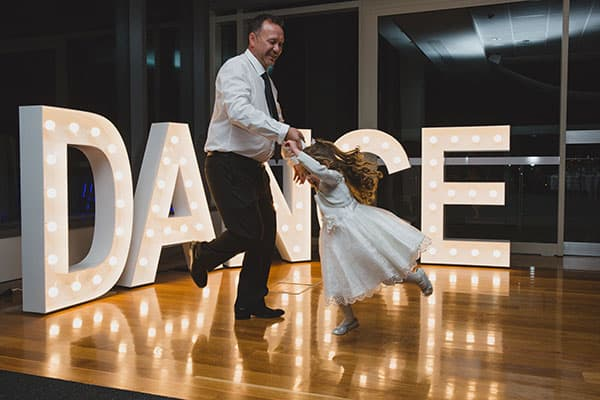 Father daughter dance at Old Government house with light up DANCE sign.