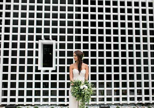 Bride outside industrial wedding venue, The Joinery.