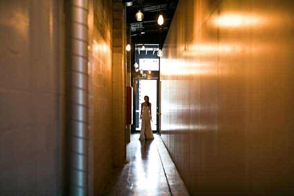 Bride walking through the corridor at The Joinery.