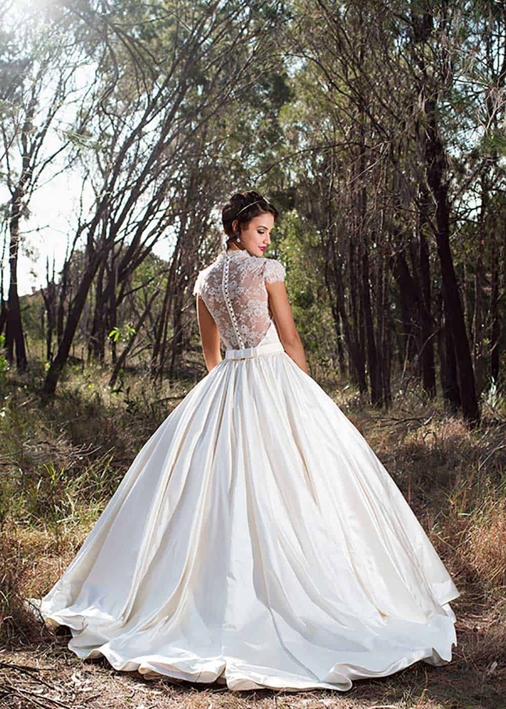 Lace backless wedding gown by Jordanna Regan.