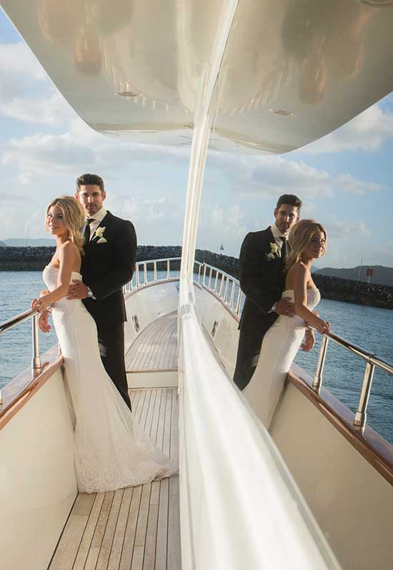 Couple on board a yacht in the marina at Lure Whitsundays