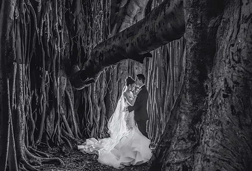 Bride and groom in the woods by Porfyri Photography