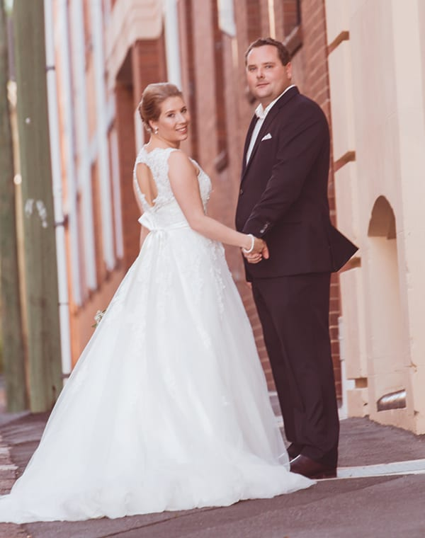 Bride and groom outside the Teneriffe Woolstore apartments