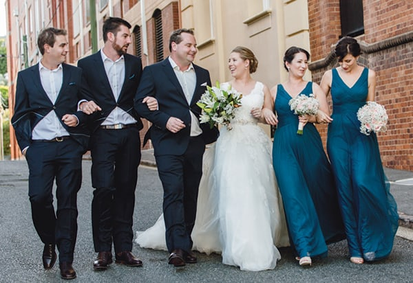 Bridal party walking to reception
