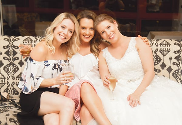 Bride and two guests on the lounge.