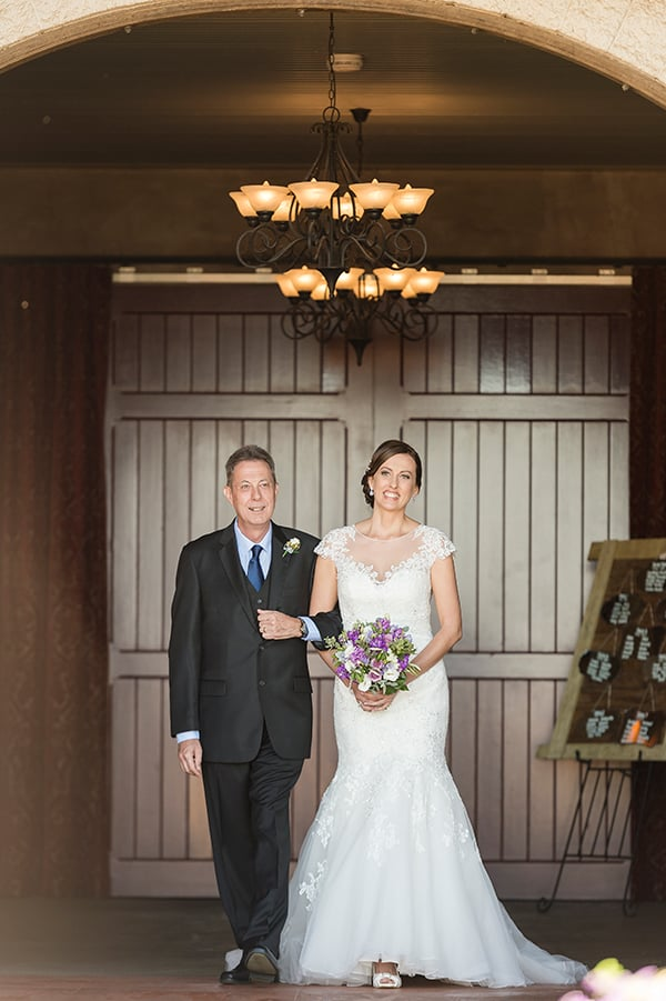 Bride and her father walking down the aisle at Flaxton Gardens