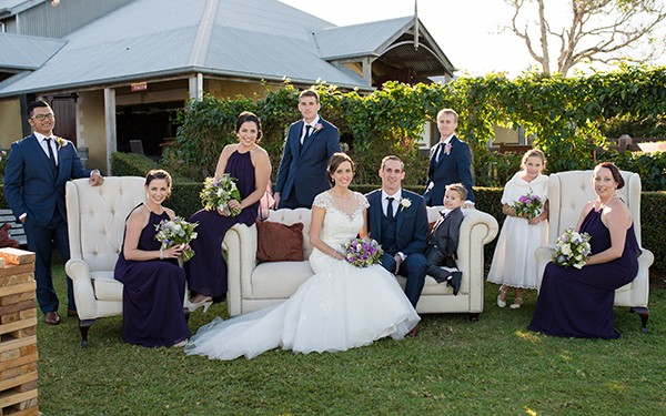 The wedding couple and bridal party on the lawn at Flaxton Gardens