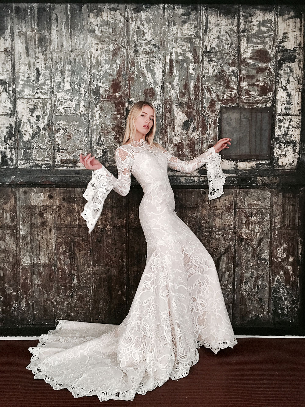 Jack Sullivan Belle lace gown with bell sleeves and train.