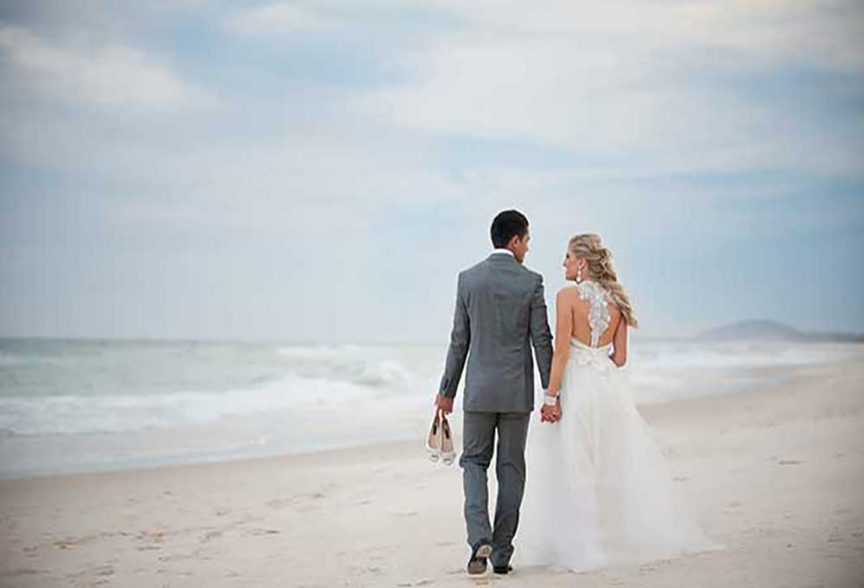 Bride and groom for their beach wedding in winter