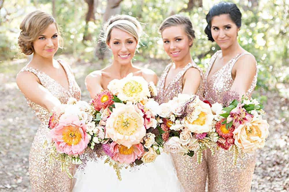 Bride with her wedding florals.