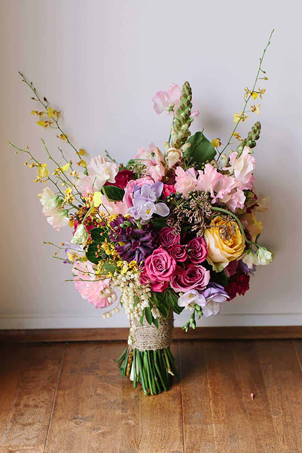 Gorgeous floral bouquet with pink, purple, yellow and green tones.