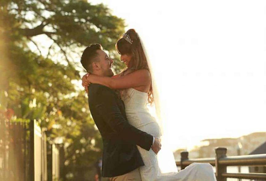 Bride and groom at their lagoon-side Surfers Paradise Marriott Resort & Spa