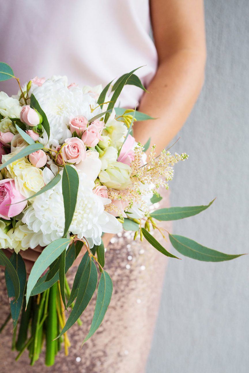 Hand-tied floral bouquet with pink roses and gum leaves. Photo: Bonavita Photography.