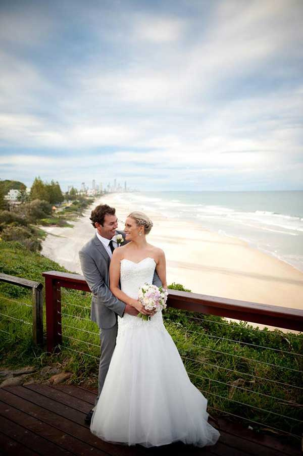 Bride and groom with the beach in the background