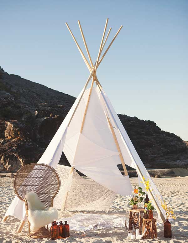 Wedding teepee for two on the beach.