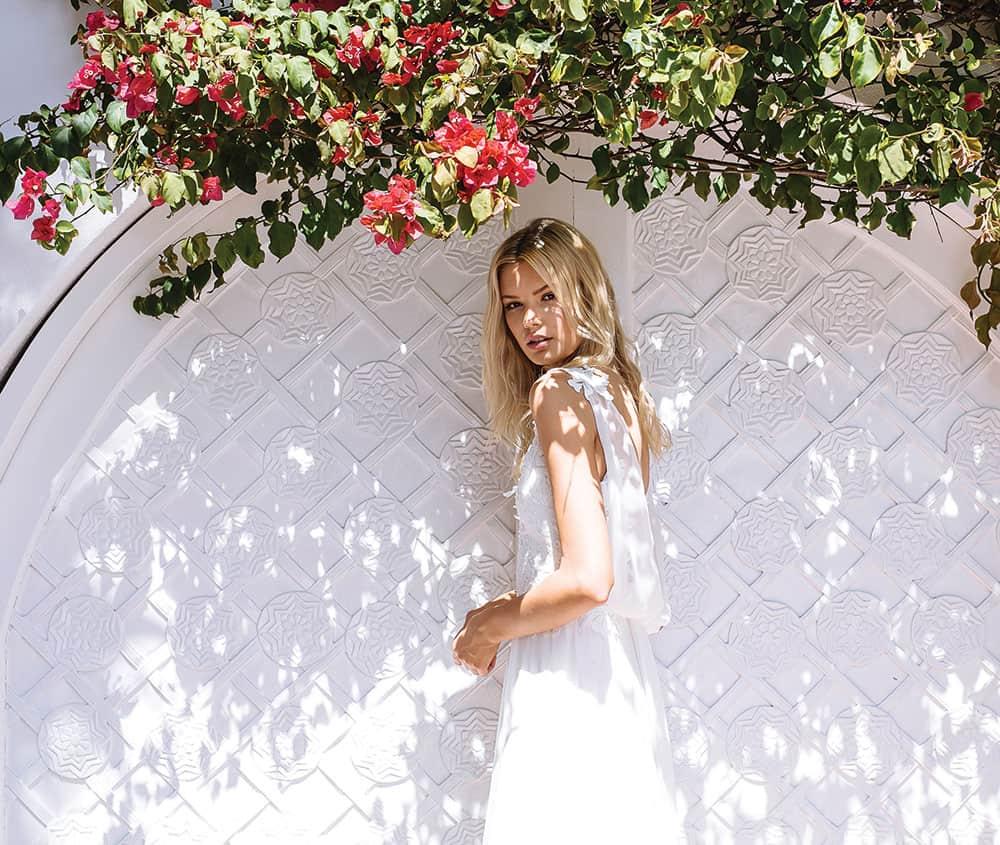 Destination wedding: Bride under a flowering tree