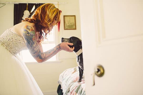 Bride saying goodbye to her dog before the wedding