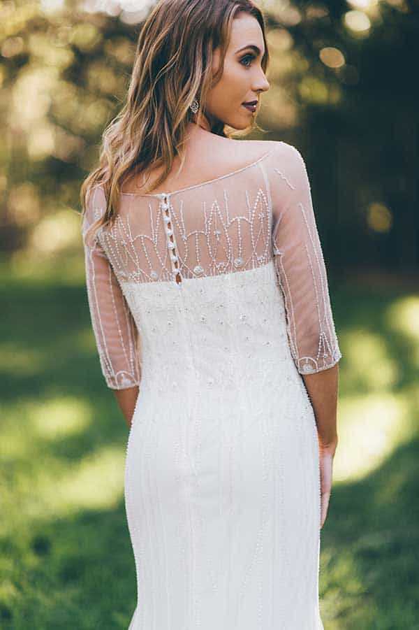 Three-quarter sheer embellished sleeve on the Aurore gown byWendy Makin at BellaDonna Bridal.