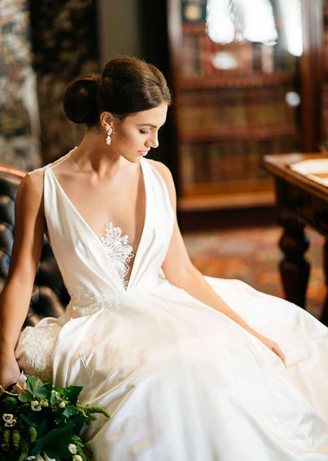 Sheer plunge neckline wedding gown from Toscano Bridal 's 2016 bridal couture collection.