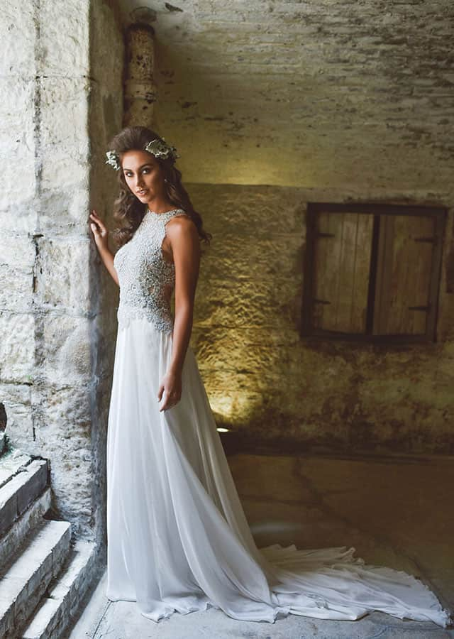 Embellished bodice with long train wedding gown from Toscano Bridal 's 2016 bridal couture collection.