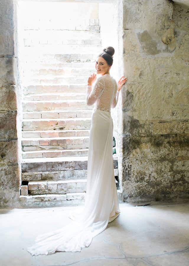 Long sleeve laced wedding gown from Toscano Bridal 's 2016 bridal couture collection.