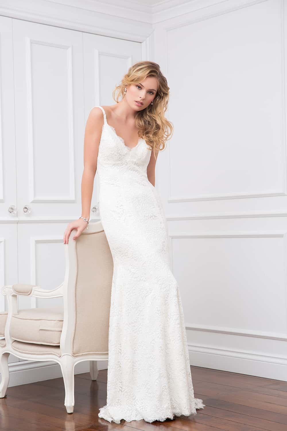 The Alice wedding gown with spaghetti strap and lace trim from Wendy Makin Couture.