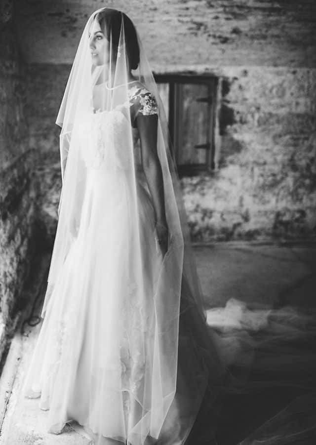 Veiled bride wearing gown from Toscano Bridal 's 2016 bridal couture collection.