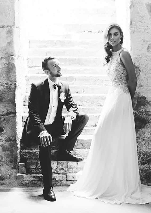 Groom with bride wearing wedding gown from Toscano Bridal 's 2016 bridal couture collection.