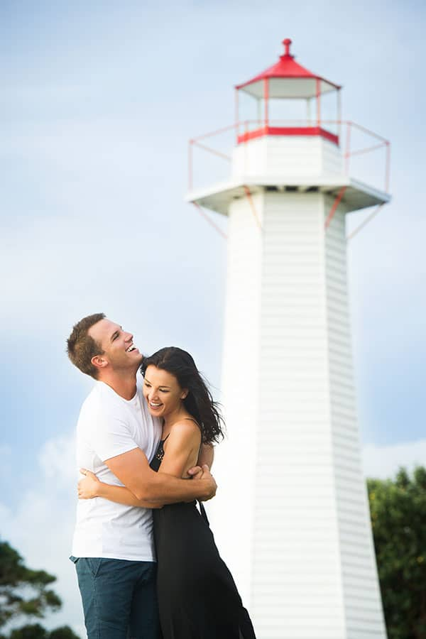 Bride and groom to-be engagement photo session at a lighthouse.
