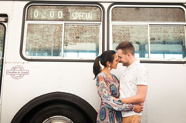 Engagement photo session outside a vintage bus.